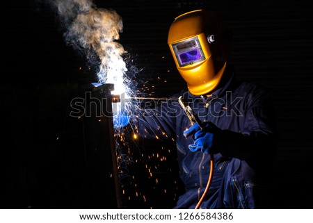 Worker welder working welding steel in industry with safety mask safety gloves and safety equipment. Wolker welding concept. #1266584386