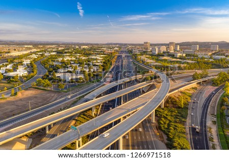Aerial view above a freeway in Orange County California on a sunny day. #1266971518