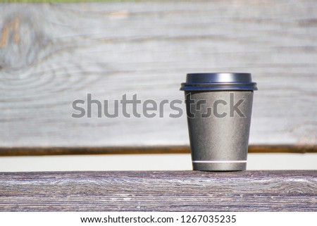 Hot drink take away coffee paper cup against a wooden background. Empty copy space #1267035235