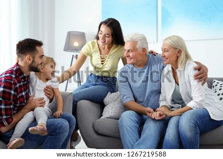 Happy family at home. Reunion of generations #1267219588