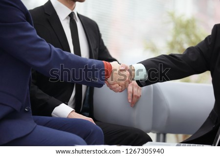 close up.handshake between Manager and client as a sign of cooperation #1267305940