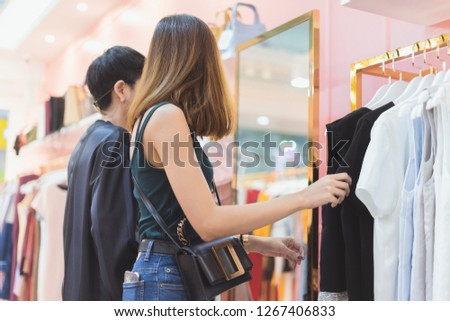 Girls shopping in style shop #1267406833