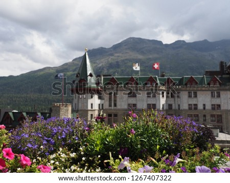 Beautiful flowers and historical building in european city center of St. Moritz at alpine landscapes in Switzerland with cloudy blue sky in 2018 warm sunny summer day on August. #1267407322