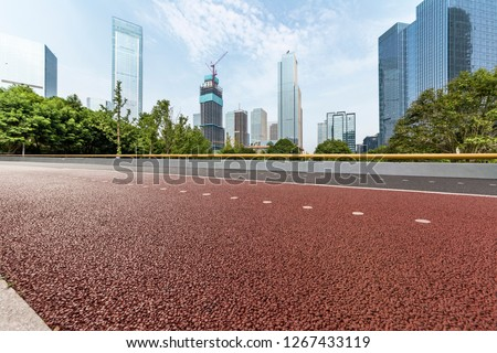 Panoramic skyline and modern business office buildings with empty road,empty concrete square floor #1267433119