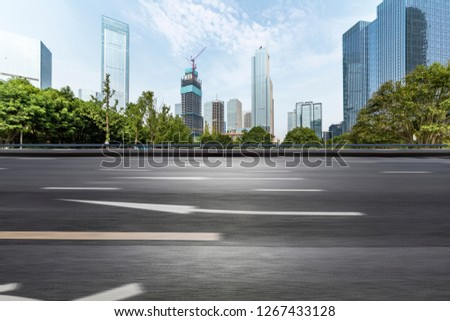 Panoramic skyline and modern business office buildings with empty road,empty concrete square floor #1267433128