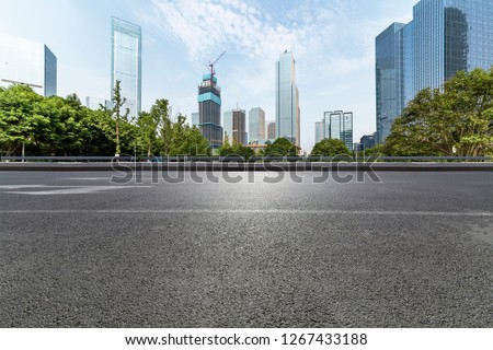 Panoramic skyline and modern business office buildings with empty road,empty concrete square floor #1267433188
