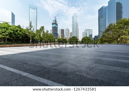 Panoramic skyline and modern business office buildings with empty road,empty concrete square floor #1267433581