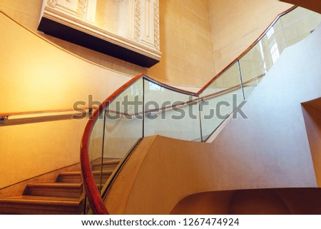 PARIS, FRANCE - OCTOBER 03, 2018: Curved stairs at Louvre Museum. No people in the building #1267474924