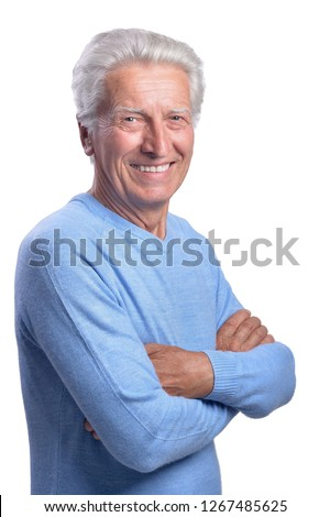 Smilling senior man posing on white background #1267485625