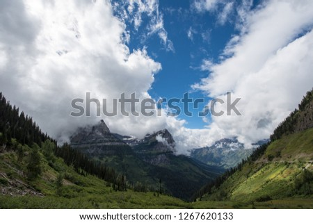 Scenery along Going to the Sun Road in Glacier National Park in Montana USA. Negative space in the sky #1267620133