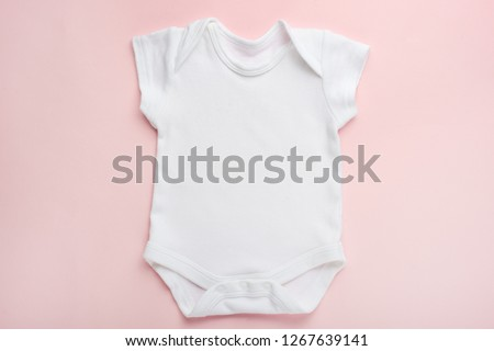 Layout Flat Lay white baby shirt bodysuit, on a pink background, for girls. Mock up for design and placement of logos, advertisements #1267639141