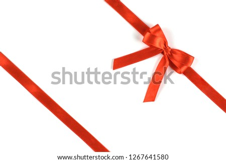 Shiny red silk ribbon isolated on white background. Festive concept. Flat lay. #1267641580