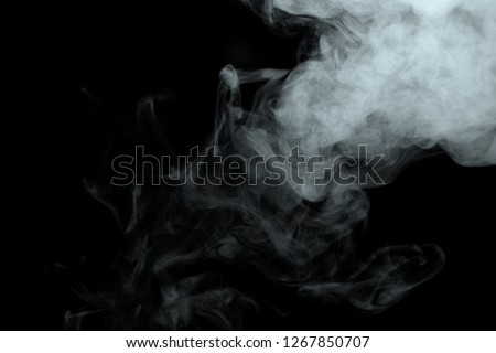 Abstract powder or smoke isolated on black background #1267850707
