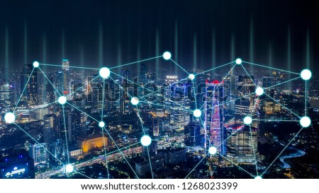 Aerial view of high buildings with connection network in Jakarta city at night time #1268023399