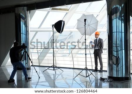 Photographer shoots architect
