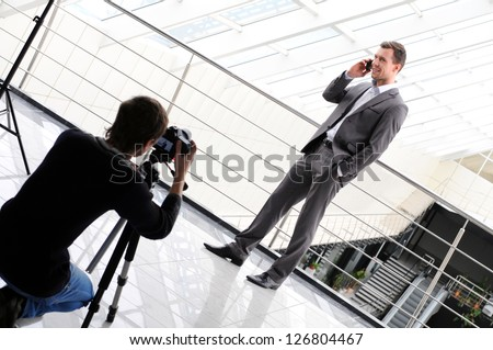 photographer shoots a business man with phone