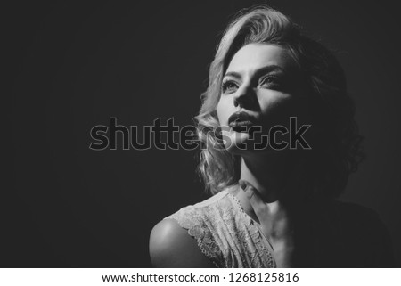 Pinup woman, vintage, skincare, look. pinup woman with happy face on dark background, copy space #1268125816
