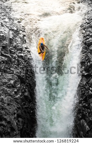 sport extrem kayak raft water white danger waterfall rapid courage courageous kayaker in a vertical diving position sport extrem kayak raft water white danger waterfall rapid courage color colour fast Royalty-Free Stock Photo #126819224