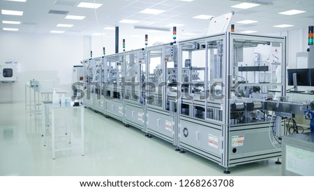 Shot of Sterile Precision Manufacturing Laboratory with 3D Printers, Super Computers and other Electrical Equipment and Machines suitable for Pharmaceutics, Biotechnology and Semiconductor Researches. #1268263708