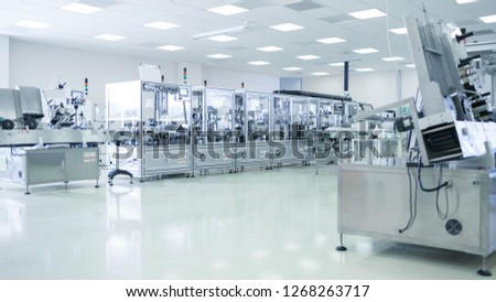 Shot of Sterile Precision Manufacturing Laboratory with 3D Printers, Super Computers and other Electrical Equipment and Machines suitable for Pharmaceutics, Biotechnology and Semiconductor Researches. #1268263717