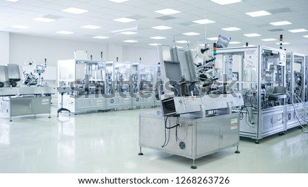 Shot of Sterile Precision Manufacturing Laboratory with 3D Printers, Super Computers and other Electrical Equipment and Machines suitable for Pharmaceutics, Biotechnology and Semiconductor Researches. #1268263726