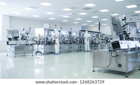 Sterile High Precision Manufacturing Laboratory where Scientists in Protective Coverall's Turn on Machninery, Use Computers and Microscopes, doing Pharmaceutics, Biotechnology Research. #1268263729
