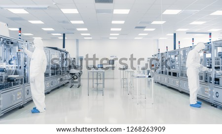 Scientists Working in Laboratory. Facility with Modern Industrial Machinery. Product Manufacturing Process: Pharmaceutics, Semiconductors, Biotechnology. #1268263909