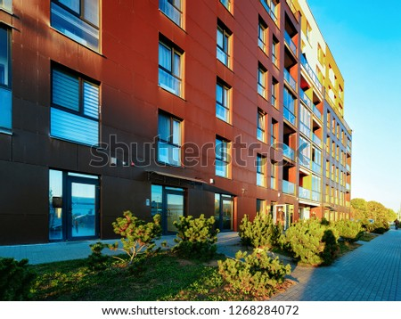 Vilnius, Lithuania - October 9, 2018: Residential Apartment homes facade architecture with outdoor facilities. Blue sky on the background. #1268284072