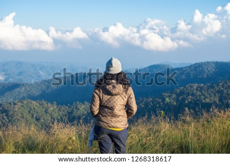 rear of happy woman stand on top mountain looking view with mist and cloud at Doi Langka Luang, Chiang Rai province. soft focus. #1268318617