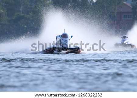 """KHONKAEN,THAILAND - November 24:One of the participants in action at """"Singha F1 Powerboat Thailand 2018"""",Bueng Nong Kho Pond ,KhonKaen,November 24, 2018. KhonKaen, Thailand. #1268322232"""
