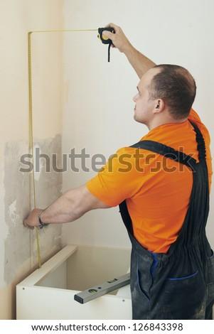 Craftsman carpenter at kitchen installation service work #126843398