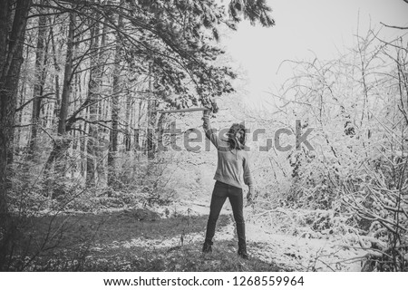 skincare and beard care in winter, beard warm in winter. Camping, traveling and winter rest. Temperature, freezing, cold snap, snowfall. Bearded man with axe in snowy forest. Man lumberjack with ax. #1268559964