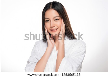 Beautiful Young asian Woman with Clean Fresh Skin look. Girl beauty face care. Facial treatment. Cosmetology, beauty and spa. #1268565133