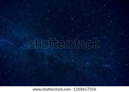 Dark Night Starry Sky Background. Royalty-Free Stock Photo #1268657356