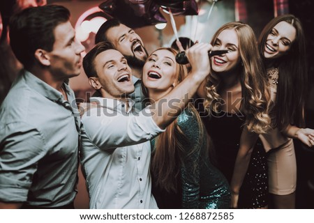 Holidays Concept. Dancing People. Great Mood. Young People. Dance Club. Sing. Microphone. Trendy Modern Nightclub. Party Maker. Birthday. Karaoke Club. Celebration. Men. White Shirt. #1268872585