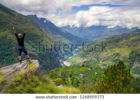 Man standing on top of the hill in Himalayas. Achievement and success. Trekking in Nepal #1268909371