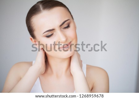 Neck Pain. Woman In Pain. Beautiful Girl Feeling Toothache #1268959678