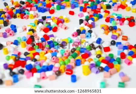 many little beads (perler beads) (Hama Beads) that are fusible when ironed, perfect for kids to use. #1268965831