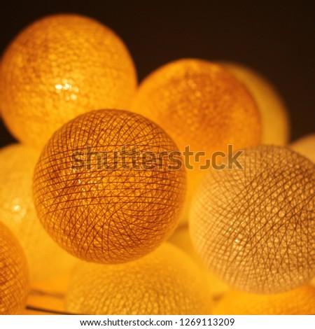 Closeup golden cotton light balls. #1269113209