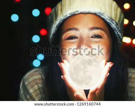 Asian Woman Holding Illuminated String Lights While laying on her bed,Christmas night concept. #1269160744