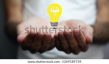 Innovative idea in businessman hand. #1269189739