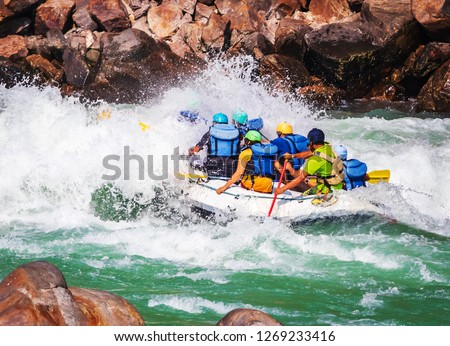 Rafting on  river Ganges in Rishikesh Uttarakhand, India.Famous tourist attraction #1269233416