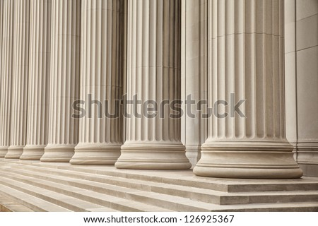 Close-up shot of a line of Gerek-style columns. Royalty-Free Stock Photo #126925367
