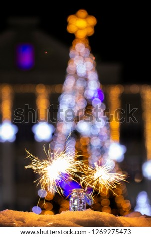 Christmas tree light night blur bokeh holiday abstract background Sparkler #1269275473