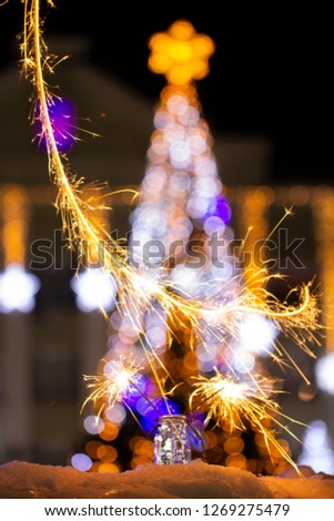Christmas tree light night blur bokeh holiday abstract background Sparkler #1269275479