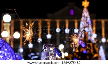 Christmas tree light night blur bokeh holiday abstract background Sparkler #1269275482