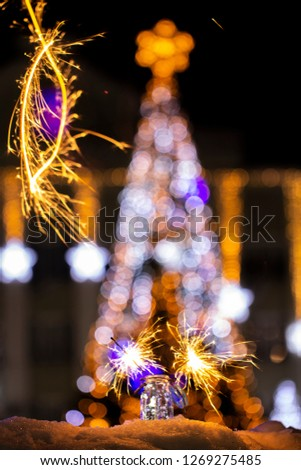 Christmas tree light night blur bokeh holiday abstract background Sparkler #1269275485
