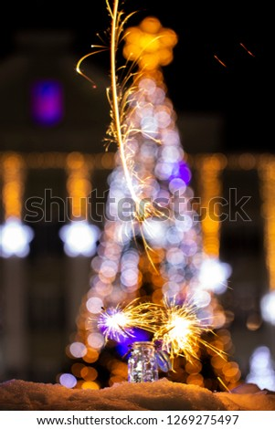 Christmas tree light night blur bokeh holiday abstract background Sparkler #1269275497