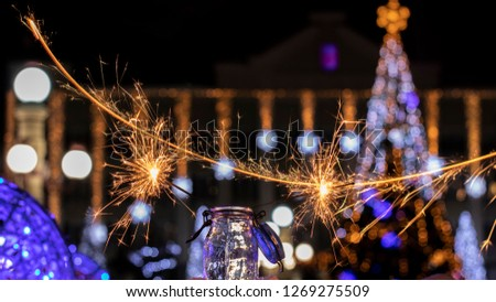 Christmas tree light night blur bokeh holiday abstract background Sparkler #1269275509