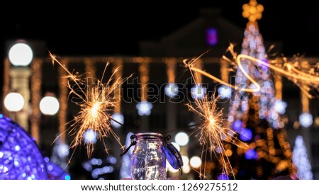 Christmas tree light night blur bokeh holiday abstract background Sparkler #1269275512